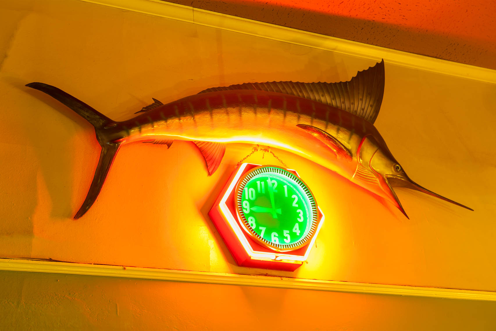 mounted swordfish and a neon clock on the wall of Paradise Cafe, Santa Barbara, California